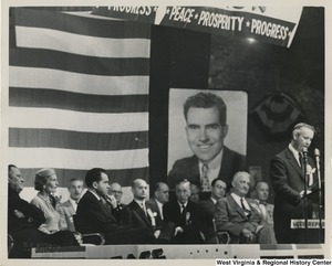 A photograph of Congressman Arch Moore speaking at a Nixon rally in Wheeling, West Virginia, as candidate for Vice President Richard Nixon looks on.