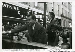 Vice Presidential candidate Richard Nixon and Pat Nixon waving at a crowd in Wheeling, West Virginia.