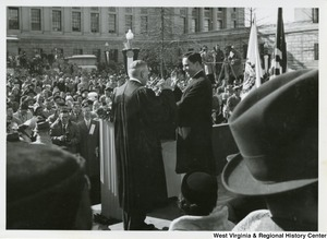 Governor Cecil H. Underwood being sworn into office by a judge during his inauguration.