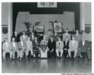 A group photograph of members of the Fraternal Order of Eagles (FOE). Congressman Arch Moore is the first person in the back on the left side.