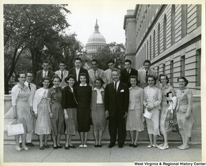 An unidentified group of people standing with Congressman Arch Moore Jr. with the Capitol Building in the background.