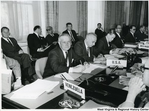 Congressman Arch Moore, Jr. with other United States representatives, along with representatives from Venezuela and the United Kingdom during a meeting.