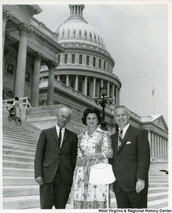 Congressman Arch Moore, Jr. and Shelley Moore with an unidentified man in front of the Capitol Building.