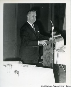 Congressman Arch Moore, Jr. standing at a podium giving a speech.