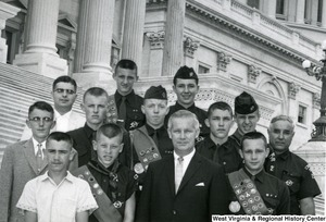 Congressman Arch Moore, Jr. with a group of Boy Scouts on the steps of the Capitol building.