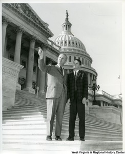 Congressman Arch Moore, Jr. standing on the steps of the capitol building with an unidentified young man.