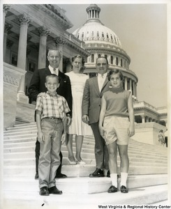Congressman Arch Moore, Jr. with an unidentified family on the steps of the Capitol Building.