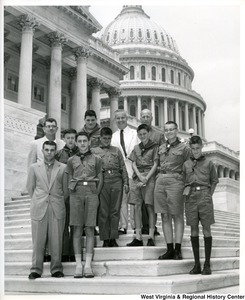 Congressman Arch Moore, Jr. with an unidentified group of Boy Scouts on the steps of the Capitol Building.