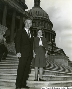 Congressman Arch Moore, Jr. standing on the steps of the Capitol Building with an unidentified girl.