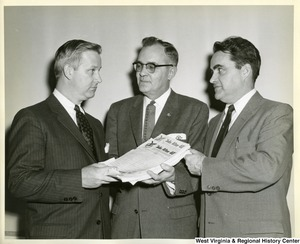 "Congressman Arch Moore, Jr. with two unidentified men. They are holding a stack of ""Jobs After 40"" petitions from the Fraternal Order of Eagles (FOE)."