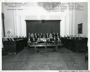 The House of Representatives for the Eighty-Sixth Congress Committee on the Judiciary. Congressman Arch Moore, Jr. is sitting fourth on the left. Representatives and staff are identified on the photograph.