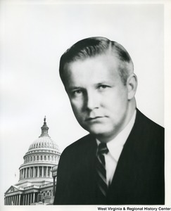 A head shot of Congressman Arch Moore, Jr. with the Capitol building in the background.