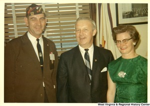 Congressman Arch Moore, Jr (center) with John L. Frazier, Department Commander of the Veterans of Foreign Wars Post in Morgantown, and Minnie Fawcett, Department President of the Veterans of Foreign Wars Ladies Post in Grafton, W.Va.