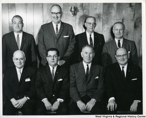 Congressman Arch A. Moore, Jr. (back row, first on the right) standing with an unidentified group of men from Weirton Steel Company.