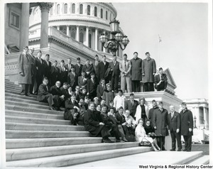 Congressman Arch A. Moore, Jr. standing on the Capitol Building steps with a group from the Veterans of Foreign Wars.