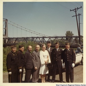Congressman Arch A. Moore, Jr. standing in front of a Market Street Bridge (Brooke County, W.V.) with a group of unidentified veterans.