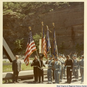 Congressman Arch Moore, Jr. standing at the beginning of the Market Street Bridge (Brooke County, W.V.) with an honor guard.