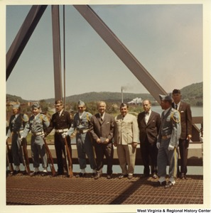 Congressman Arch A. Moore, Jr. (center) standing on the Market Street Bridge with a unidentified honor guard. In the background you can faintly see the Steubenville Railroad Bridge.