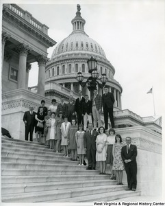 Congressman Arch A. Moore, Jr. (fifth from the bottom) standing on the Capitol Building steps with an unidentified group of people.