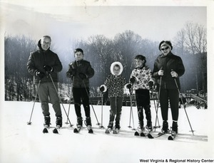 Congressman Arch Moore, Jr. on skis with his wife and three children.