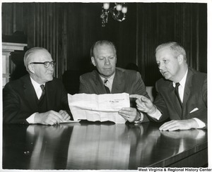 Congressmen Arch Moore, William McCulloch, and Gerald Ford looking at  H.Res. 598.