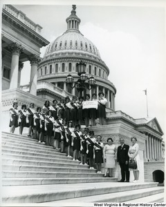 Congressman Arch A. Moore, Jr. standing with Girl Scout Cadette Troop 229, St. Michaels, Wheeling, on the steps of the Capitol Building. Pictured: Mrs. Rita Singler, Nancy Ellen Burke, Kathy Albert, Rosemary Bliske, Claudia Bliss, Beth Brieding, Kathy Culley, Helen Dickie, Linda Falkenstein, Debbie Felton, Rosemary Frabell, Susan Gantzer, Jeanie Grubler, Gretchen Gundling, Kathy Hickey, Patsy Kelly, Maureen McCarthy, Patty Matella, Susan Moyle, Elizabeth Murray, Patty Saller, Mary K. Schaub, and Lynne Werner. (This is not the  accurate order of those pictured).