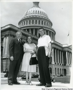 Congressman Arch A. Moore, Jr. standing next  to Mr. and Mrs. George Marovich in front of the Capitol Building.