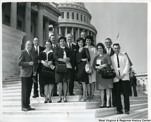 Congressman Arch A. Moore, Jr. (center, back) with a unidentified group of people on the steps of the Capitol complex.
