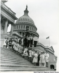 Congressman Arch A. Moore, Jr. standing with the Lewis County 4-H Club on the steps of the Capitol building.