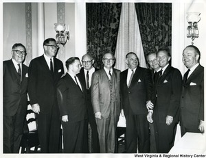 Congressman Arch A. Moore, Jr. with other congressman at Emanuel Celler's luncheon in honor of the Australian Minister, Honorable Hubert Opperman. Pictured: William T. Cahill (first on the right), Frank Chelf (second on the right), Congressman Arch A. Moore, Jr. (third from right), William M. McCulloch (center), Emanuel Celler (forth from the left), Carl Albert (third from left), and Clark MacGregor (second from left).