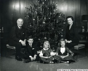 Congressman Arch A. Moore, Jr. with his wife and three children in front of a Christmas tree.