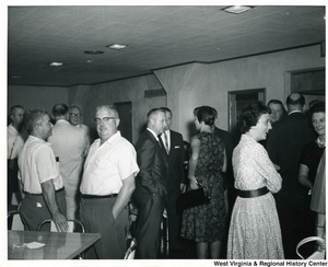 Congressman Arch A. Moore, Jr. mingling with a group of unidentified people.
