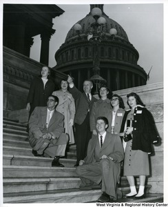 Congressman Arch A. Moore, Jr. with several individuals from a seminar of the Church of the Brethren. Moore is pointing to the approximate location of his offices in the new house office building across from the Capitol.  The  individuals are: Jean Falls, Marybell Sanders, June Sleeth, Mary Jane Kirk and Mrs. Charlene Clayton, all of Fairmont; Elwood W. Lambert, Wiley Ford and John Curtis, Keyser.