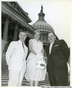 Congressman Arch A. Moore, Jr. standing on the steps of the Capitol with an unidentified couple.
