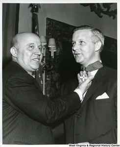 Congressman Arch A. Moore, Jr. receiving the Order of Merit of the Italian Republic from an unidentified man.