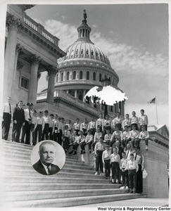 A group of unidentified young men on the steps of the Capitol Building. The boys are wearing uniforms. A portrait of Congressman Arch A. Moore, Jr., cut in a circle, has been glued to the photograph.