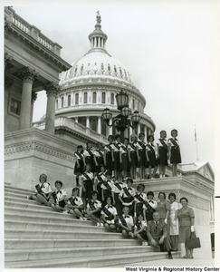 Congressman Arch A. Moore, Jr. sitting on the steps of the Capitol Building with Girl Scout Troop 415.