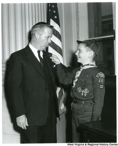 Congressman Arch A. Moore, Jr. talking to an unidentified Boy Scout from Troop 665.