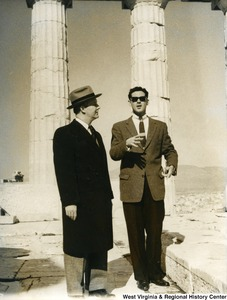 Congressman Arch A. Moore, Jr. talking with an unidentified man in sunglasses. They are standing in the Parthenon