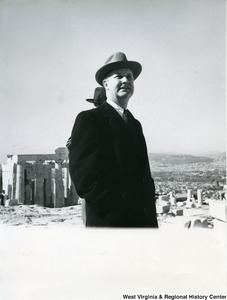 Congressman Arch A. Moore, Jr. looking at something in the distance. The Parthenon can be seen in the background.