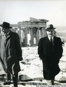 Congressman Arch A. Moore, Jr. walking away from the Parthenon. An unidentified man is beside him.