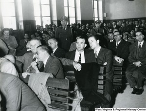 Congressman Arch Moore Jr. in Greece for the trial of U.S. Airman Marion Musilli of Benwood, West Virginia. Some officers can be seen standing in the background.