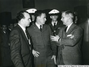 Congressman Arch Moore Jr. in Greece for the trial of U.S. Airman Marion Musilli of Benwood, West Virginia.  Some officers can be seen standing behind Moore.
