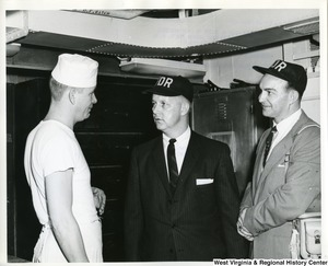 Congressman Arch A. Moore inspecting the bake shop aboard the U.S.S. Franklin D. Roosevelt. Moore and an unidentified man are talking to an unidentified crew member, presumably the baker of the U.S.S. Franklin D. Roosevelt .