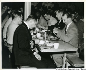 Congressman Arch A. Moore, Jr. (second from the right) eating with some of the  crew of the U.S.S. Franklin D. Roosevelt.