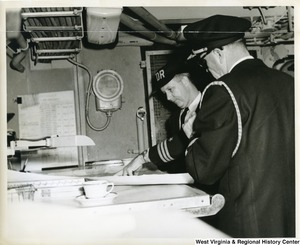 Congressman Arch A. Moore, Jr. looking over a map with the Commander of the U.S.S. Franklin D. Roosevelt.