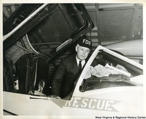Congressman Arch A. Moore, Jr. looking inside an opened aircraft on the U.S.S. Franklin D. Roosevelt.