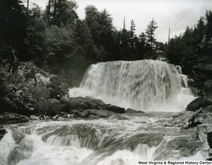 A black and white photograph from the base of Blackwater Falls.