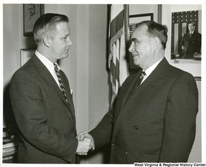 Congressman Arch A. Moore, Jr. shaking hands with Congressman Joseph (Joe) W. Martin, Jr.