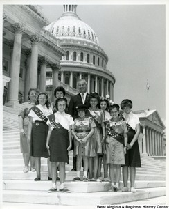 Congressman Arch A. Moore, Jr. (in the back) with Girl Scout Troop # 34 of Weirton, W. Va.